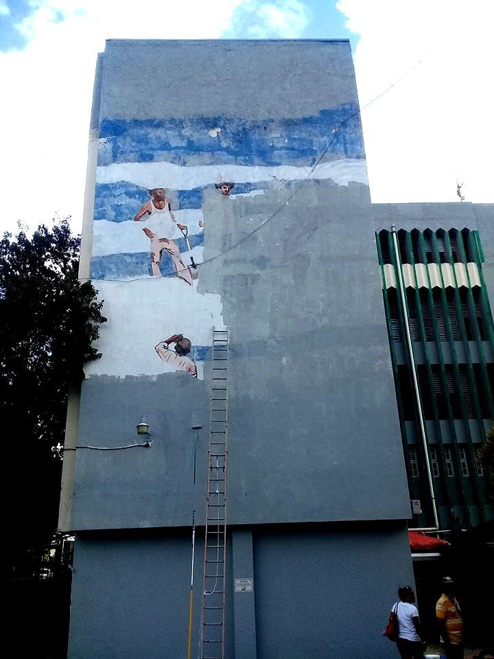 Mural borrado Vivir en las nubes, de Angel Hache. UTESA